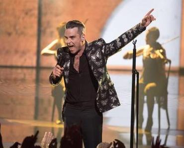 NRJ MUSIC AWARDS 2016 : Robbie Williams in  an Alexander McQueen butterfly print blazer